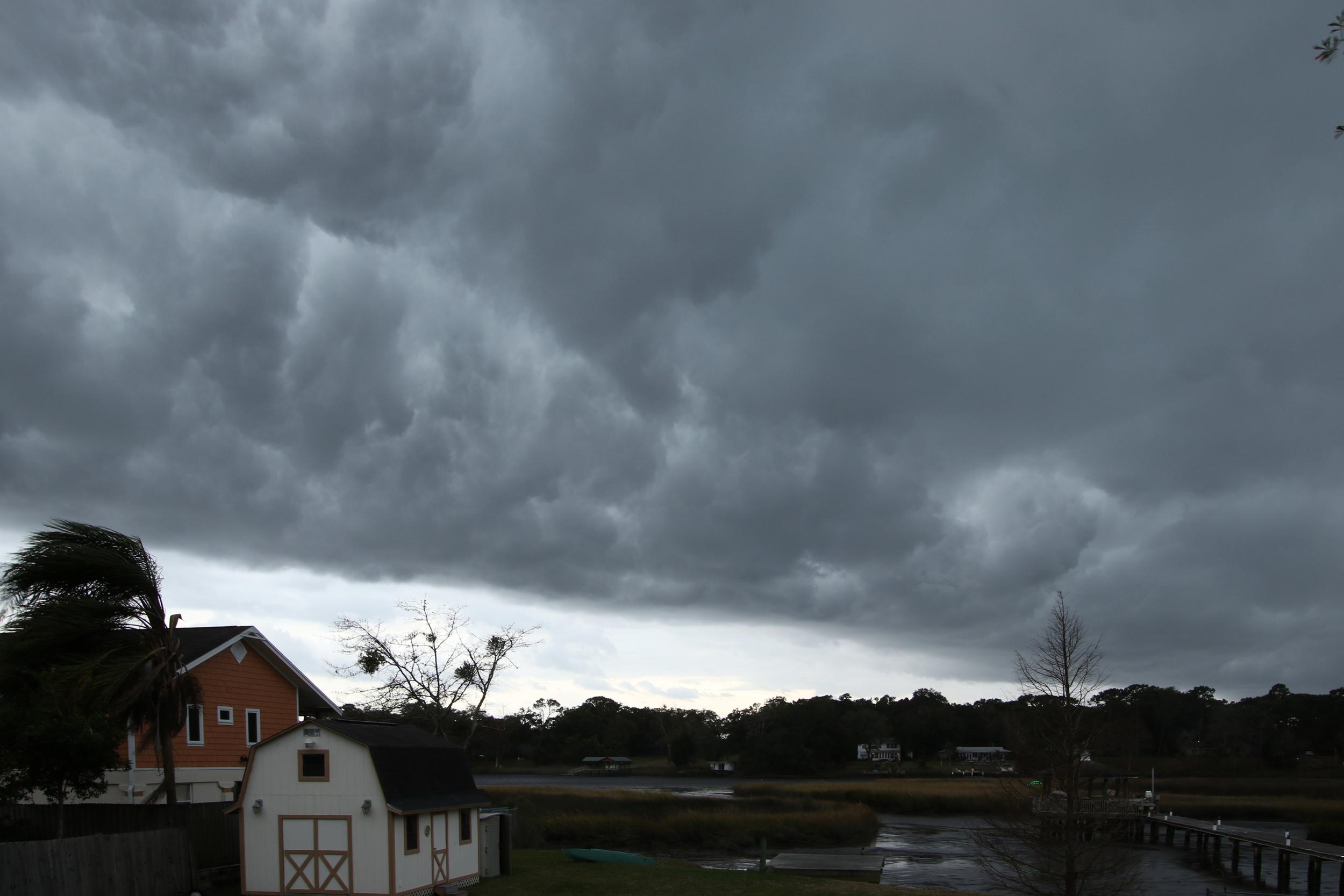 Dark grey clouds roll across the sky over the Broward..