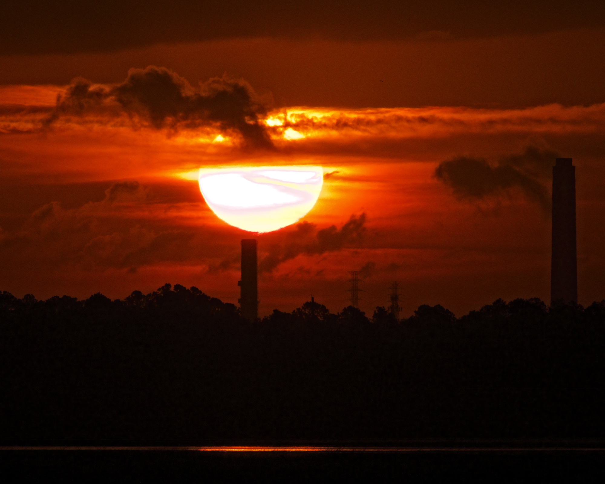 Morning Power on the Broward. The sun rises like an orb of molten glass over the power station.
