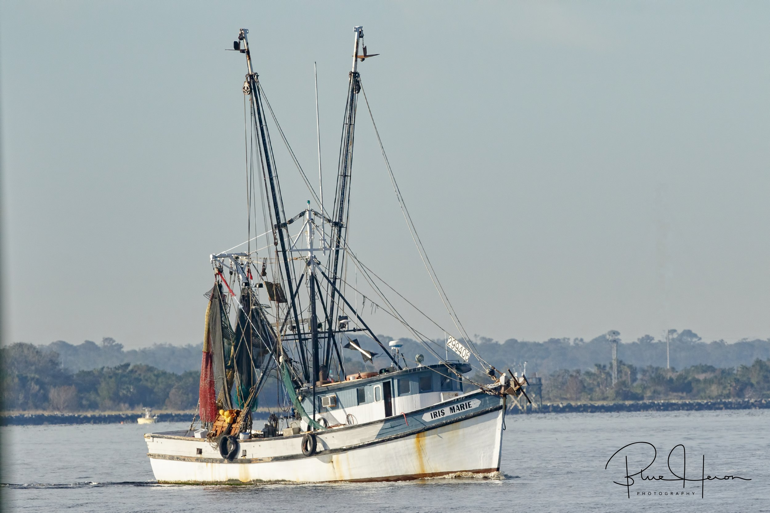A local Mayport Shrimp boat heads out to sea also..