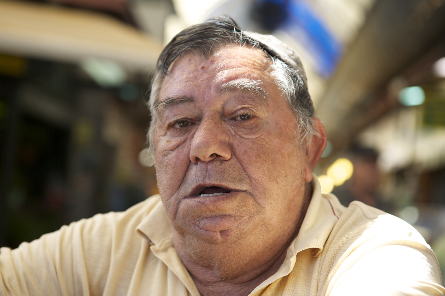 Portrait of a man at the Mahane Yehuda Market in Jerusalem, Israel.
