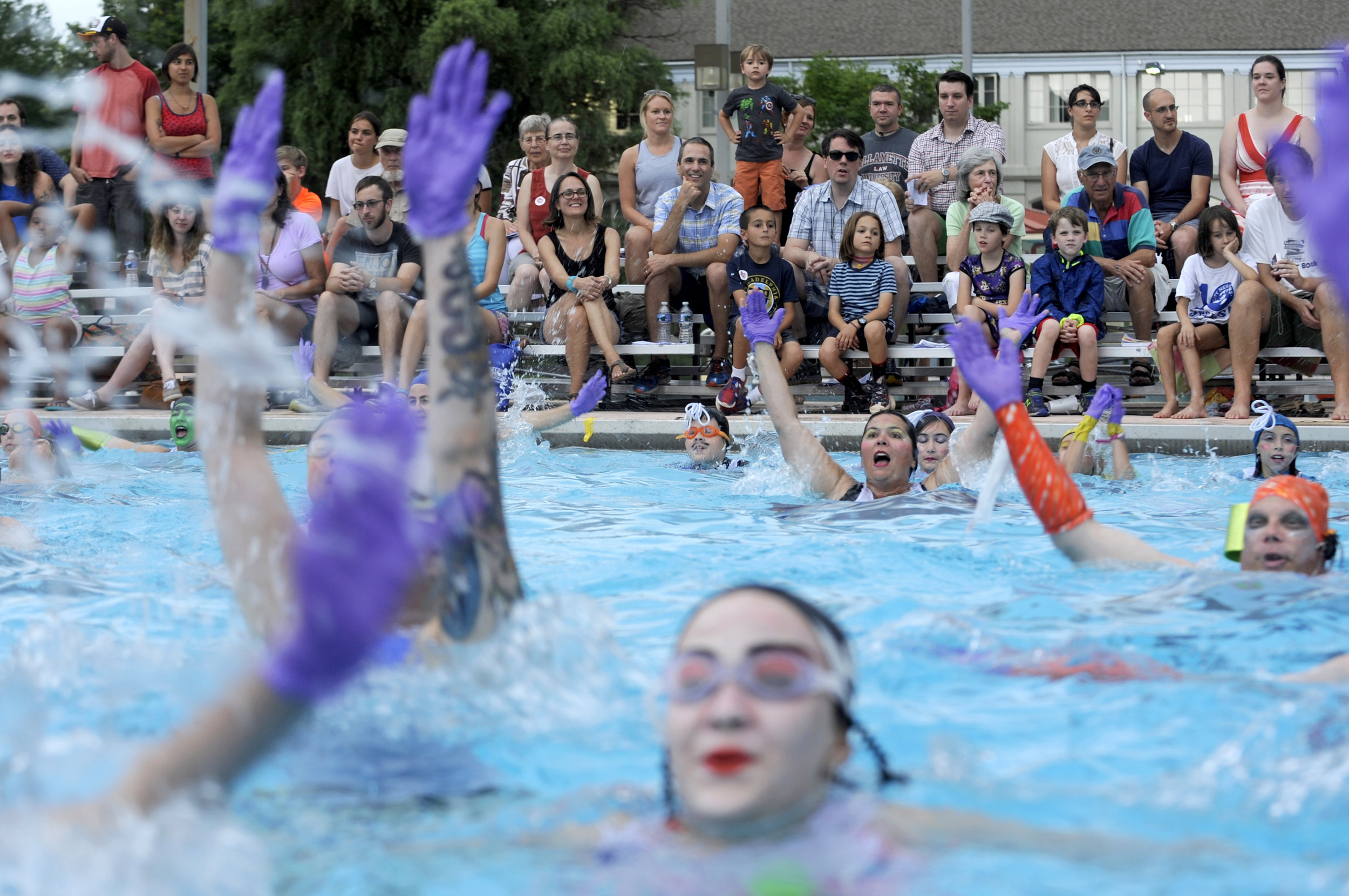 Fluid Movement, a Baltimore-based performance art group known for offbeat water ballets, roller skating musicals and disco workouts, performs its 15th annual synchronized swimming ballet at Druid Park Pool in Baltimore, Maryland on Saturday, July 30, 2016.