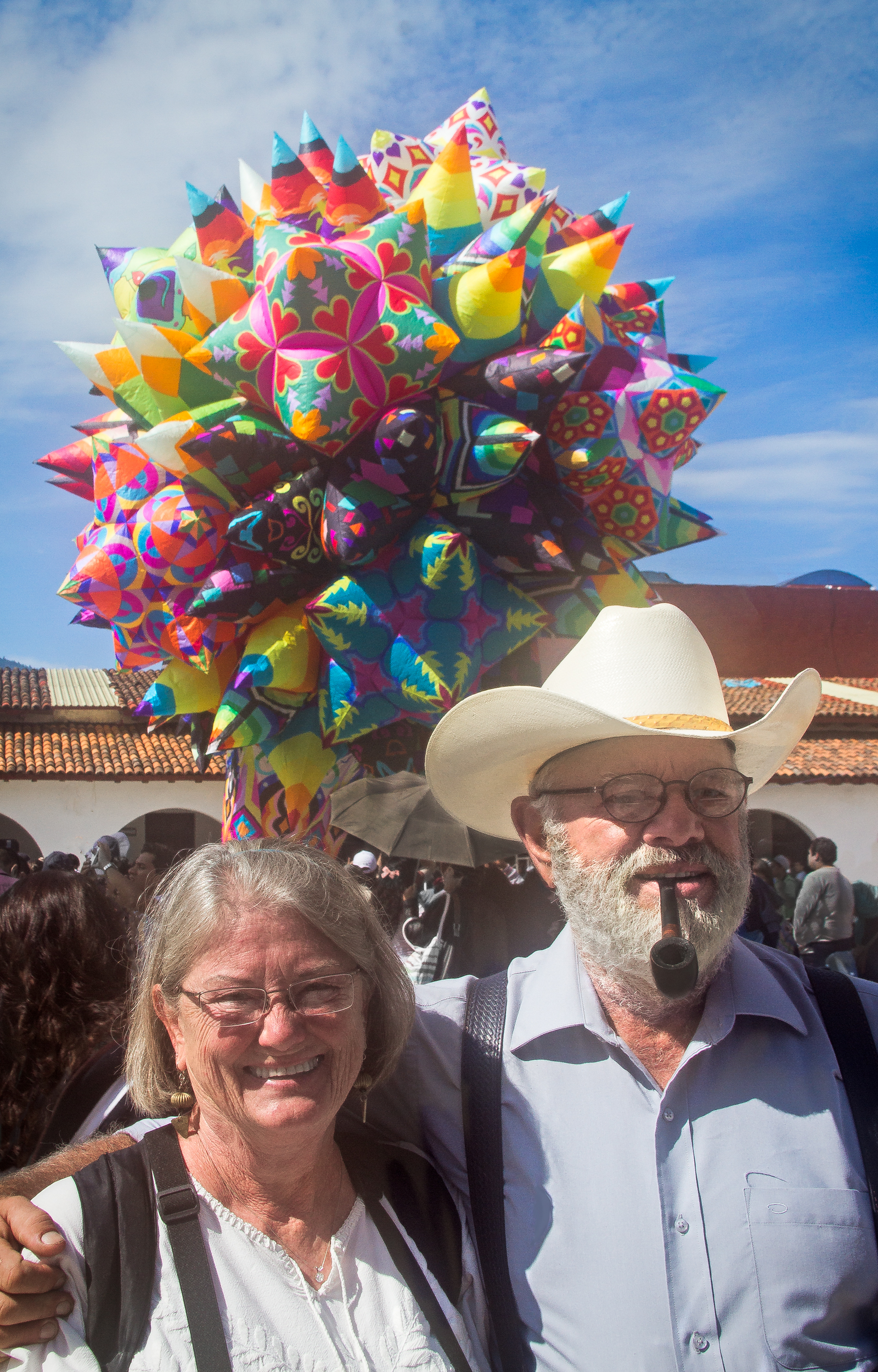 Linn & David in front of a gorgeous, multi-faceted,crêpe-paper balloon.   CantoyaFest: Paracho, Michoacán, Mexico — Sunday, July 20, 2014