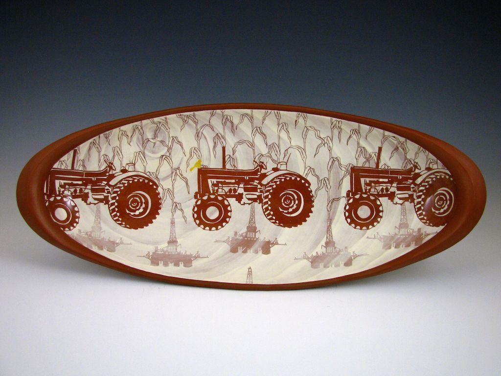 An oval bowl combining stenciling and sgraffito techniques}