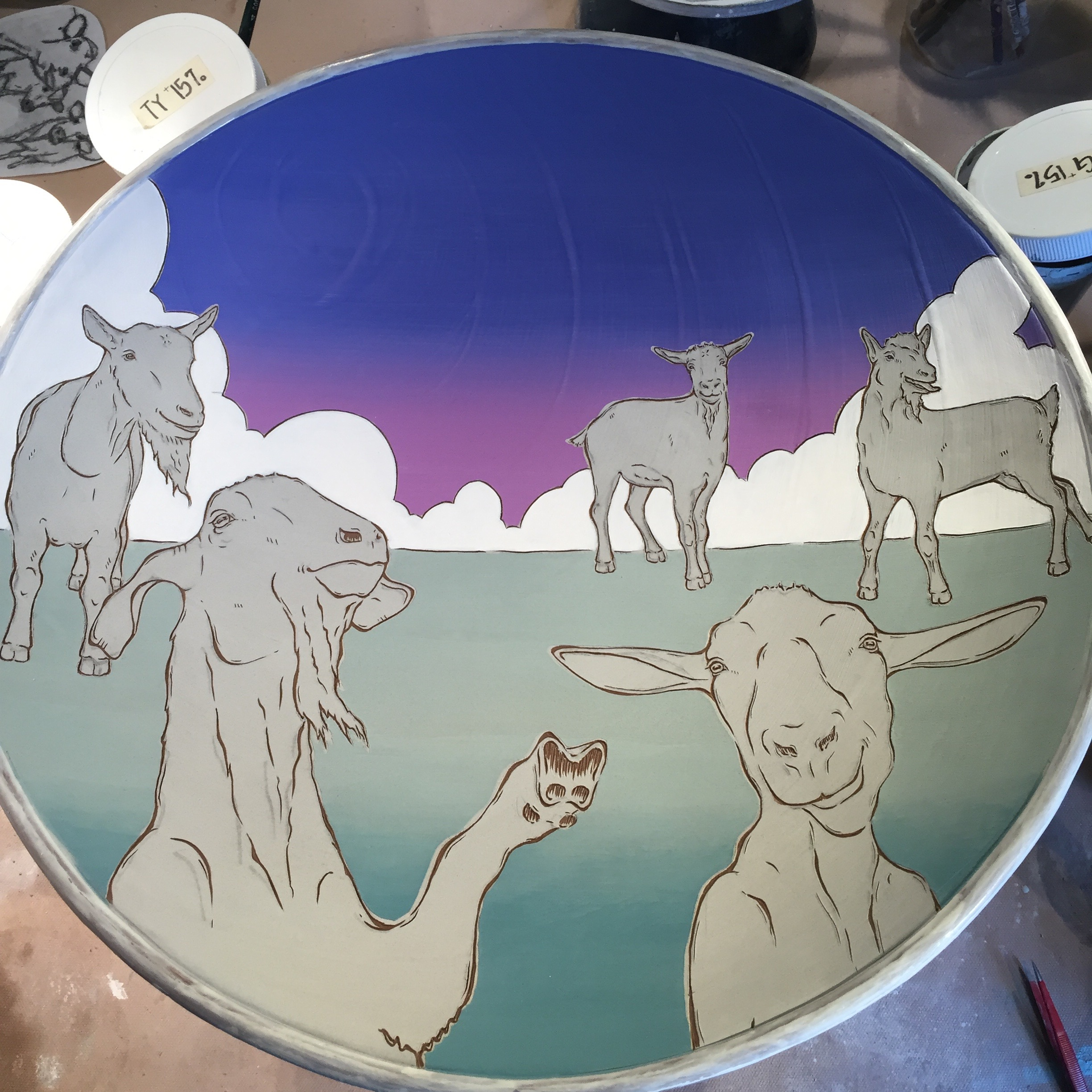 Leather hard goat platter ready for green glazing