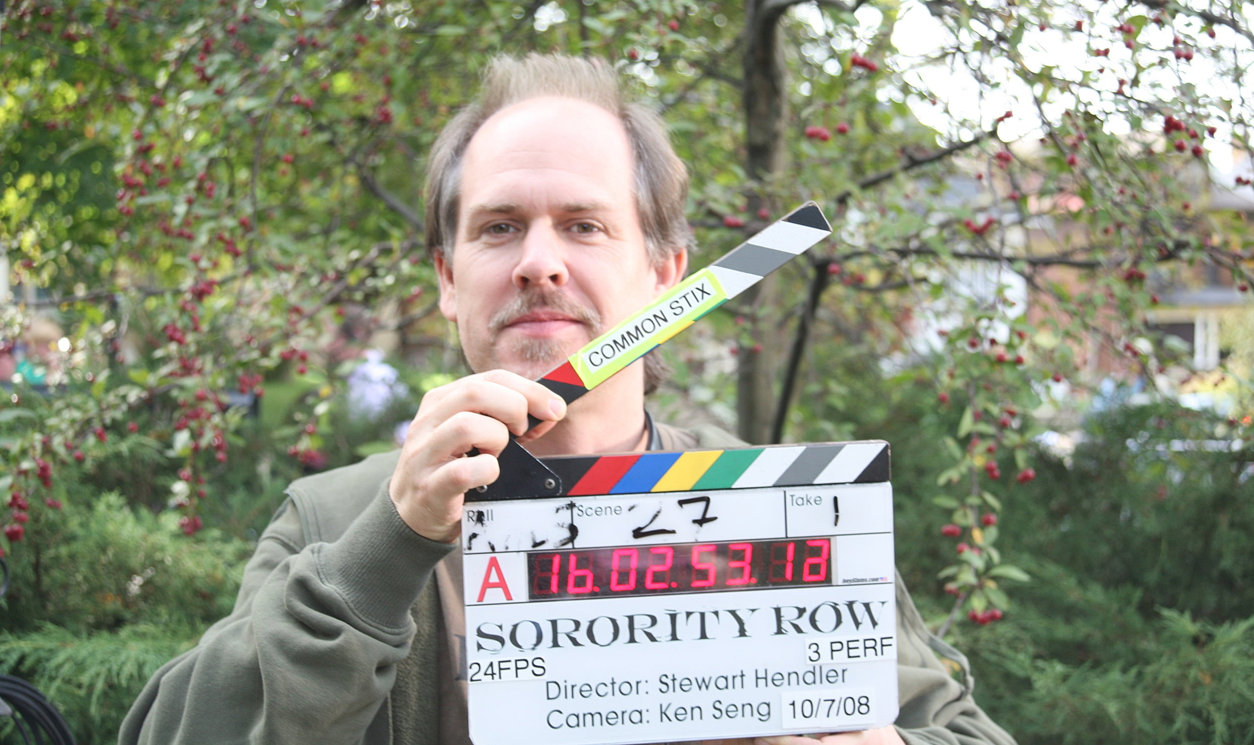 Slowing down production on Sorority Row by dorkily posing with the sticks.