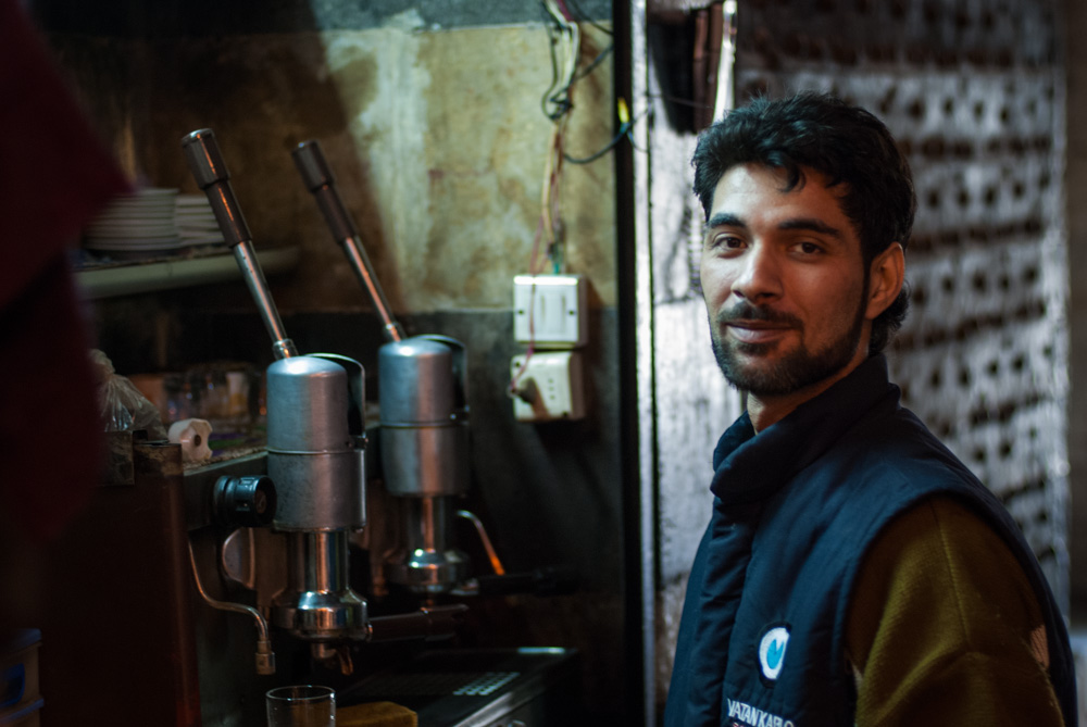 A coffee seller poses for a portrait in a souq of Aleppo's Old City. November 2009.