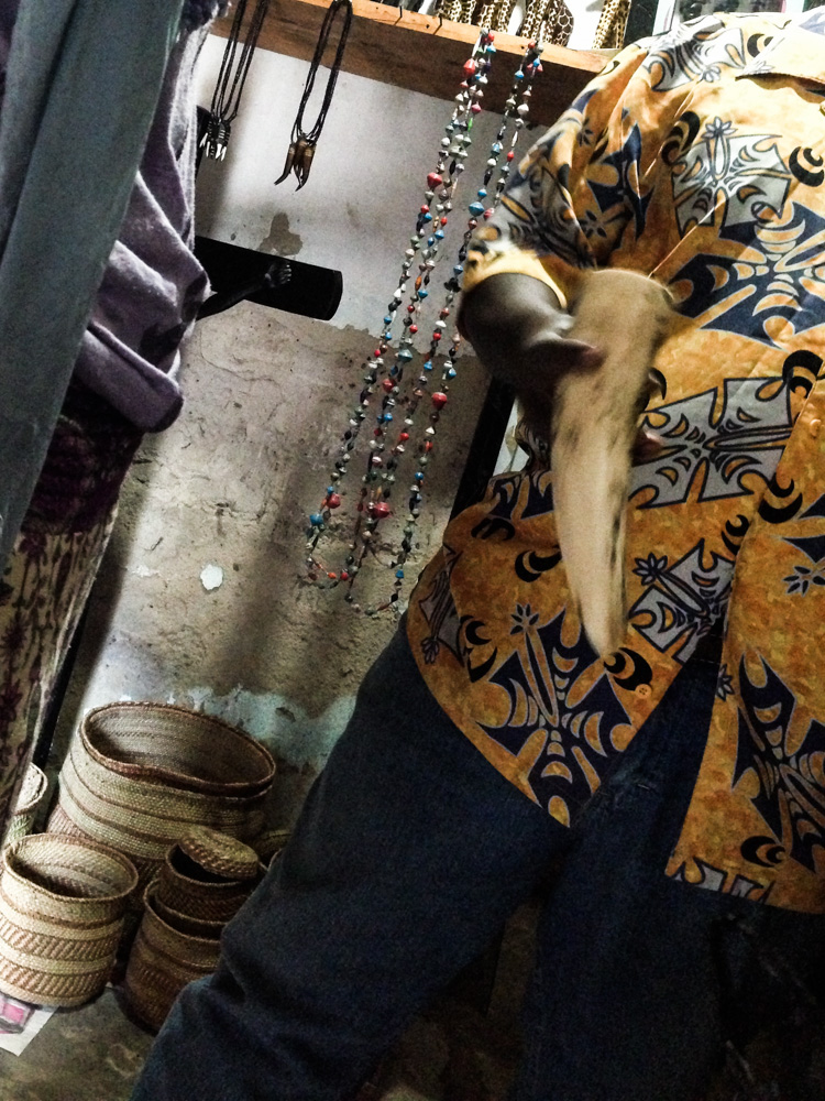 A stallholder in a Dar es-Salaam tourist market offers a piece of tusk for sale