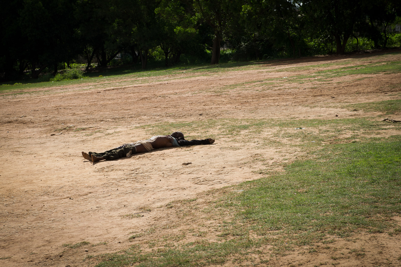 A man that the army claims was involved in fighting between the DRC armed forces lies dead in a field next to the Bel Air cemetery in Lubumbashi, killed in clashes between the armed forces and a group of armed men calling for secession of Katanga province.