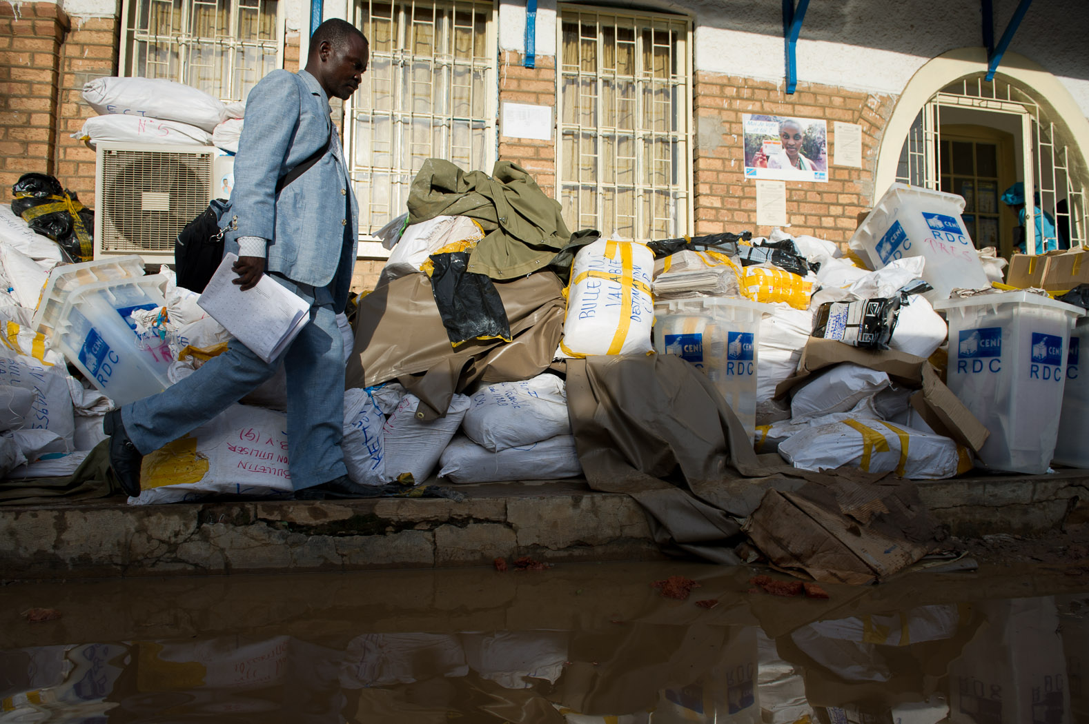 The Independent National Electoral Commission (CENI) building was ill-prepared to deal with the volume of ballots, leaving stacks of cast-ballots and voting materials outside in the rains.
