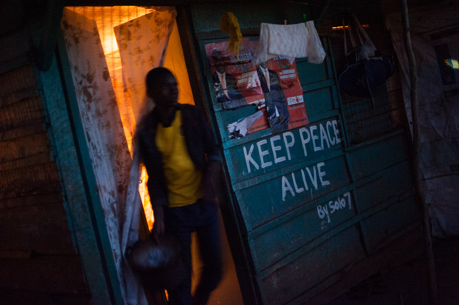 """Kibera graffiti artist, Solo 7, took to the streets following the 2007/8 post-election violent, painting slogans of peace throughout the slum. Ahead of the 2013 elections, he covered the slum in graffiti such as the iconic slogan """"Keep Peace Alive""""."""