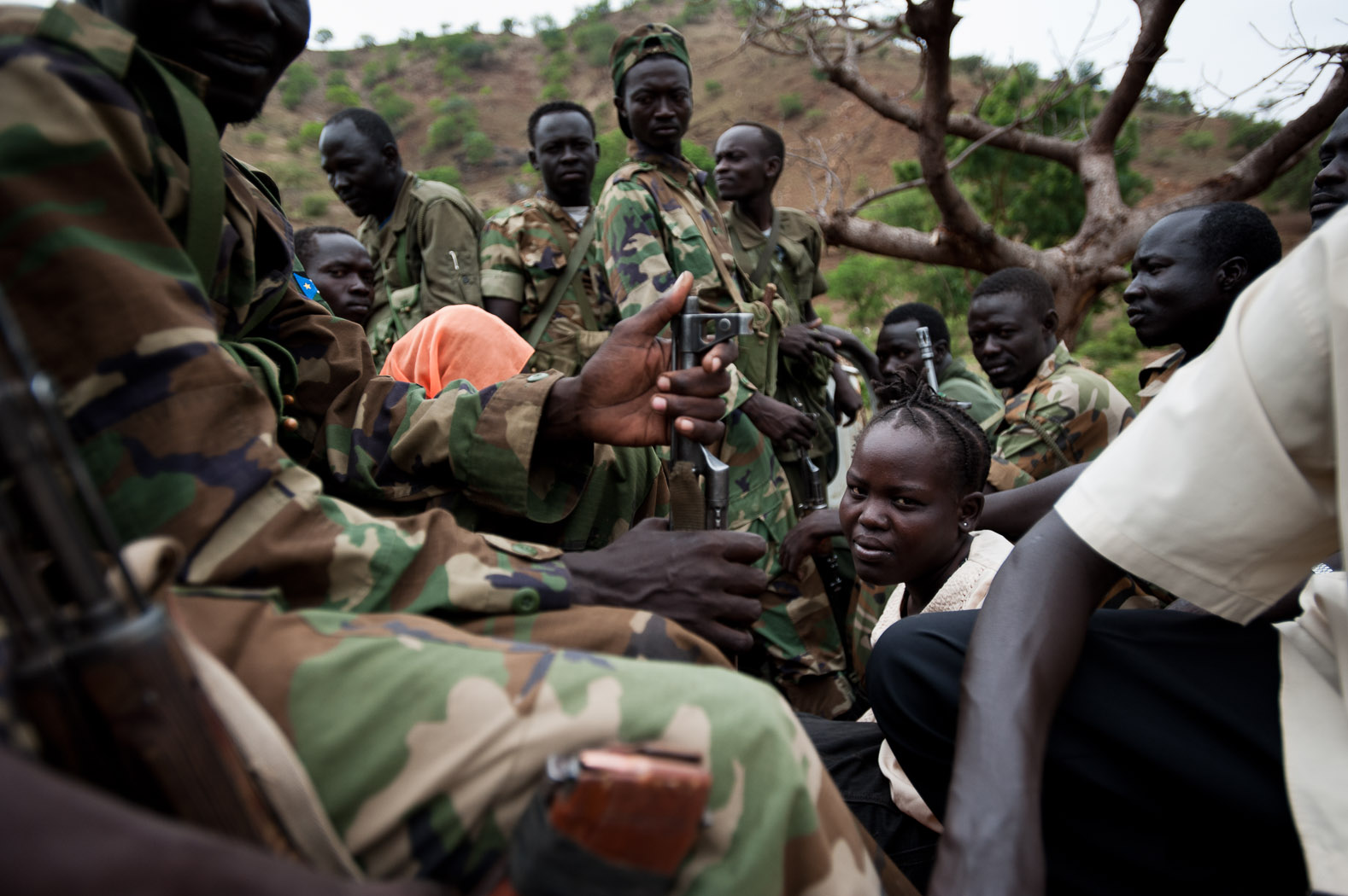 A group of SPLM-North troops drive through the rocky roads in the Nuba mountains of Sudan's South Kordofan state, transporting with them a civilian lady in this unforgiving landscape.
