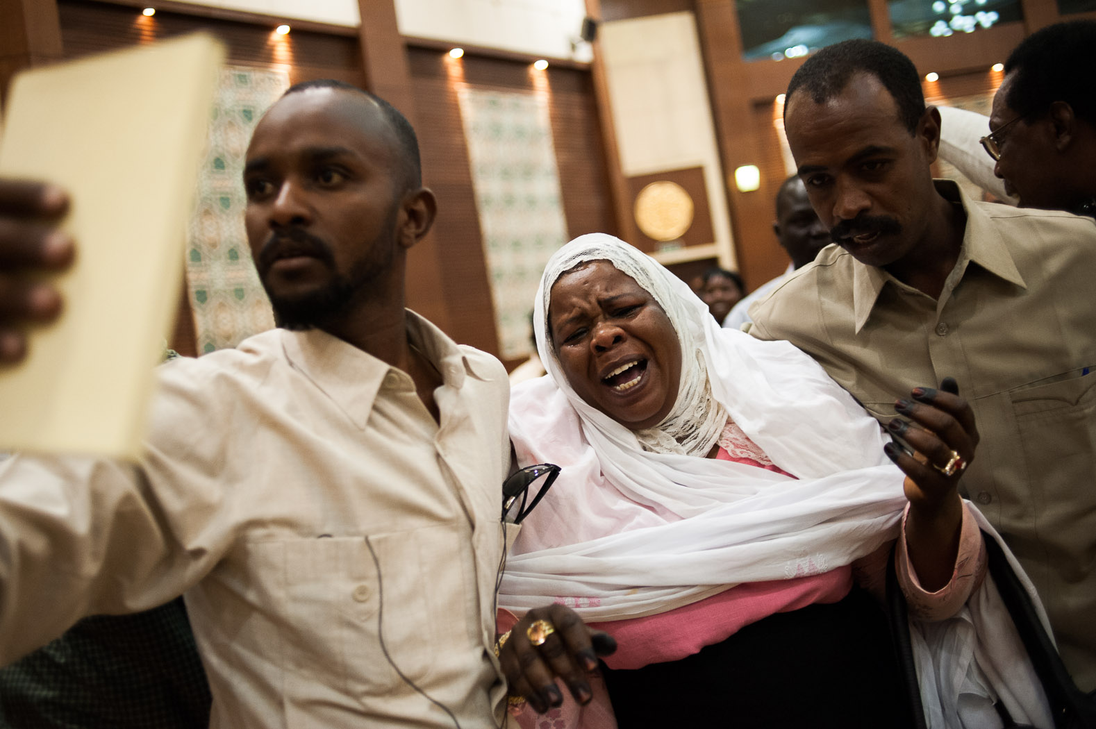 """On February 7, 2011, the full, final results were announced in Khartoum.  Nearly 99% of South Sudanese across the world had chosen secession, which was acknowledged and accepted by Sudan's president, Omar al-Bashir.  Not everyone was happy, though. This Sudanese woman in Khartoum was escorted from the hall in Khartoum as she lamented that """"Sudan is one country, not two""""."""