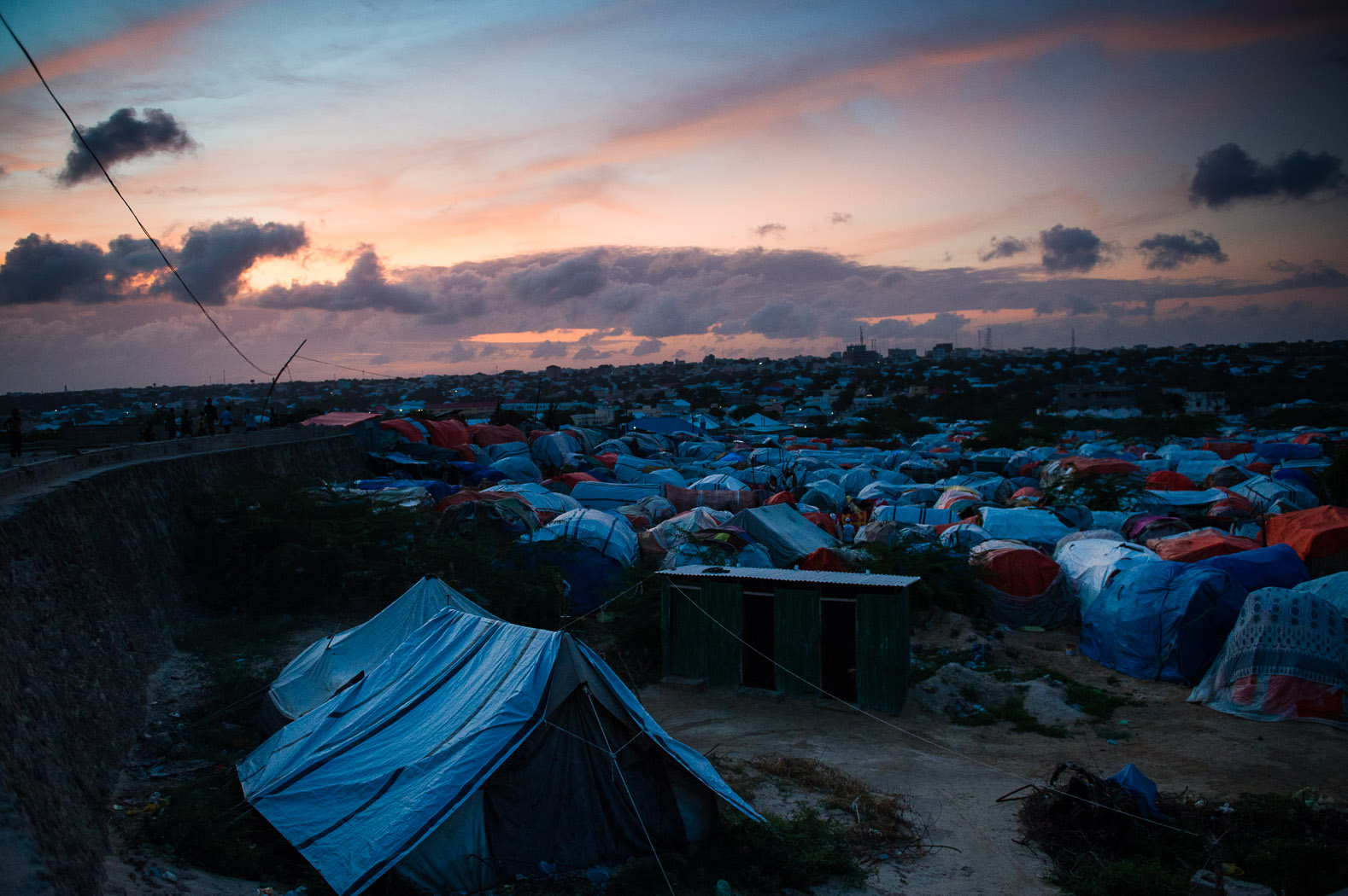 Thousands of Somalis still live in makeshift camps for the internally displaced, squeezed in wherever there is space in the capital.