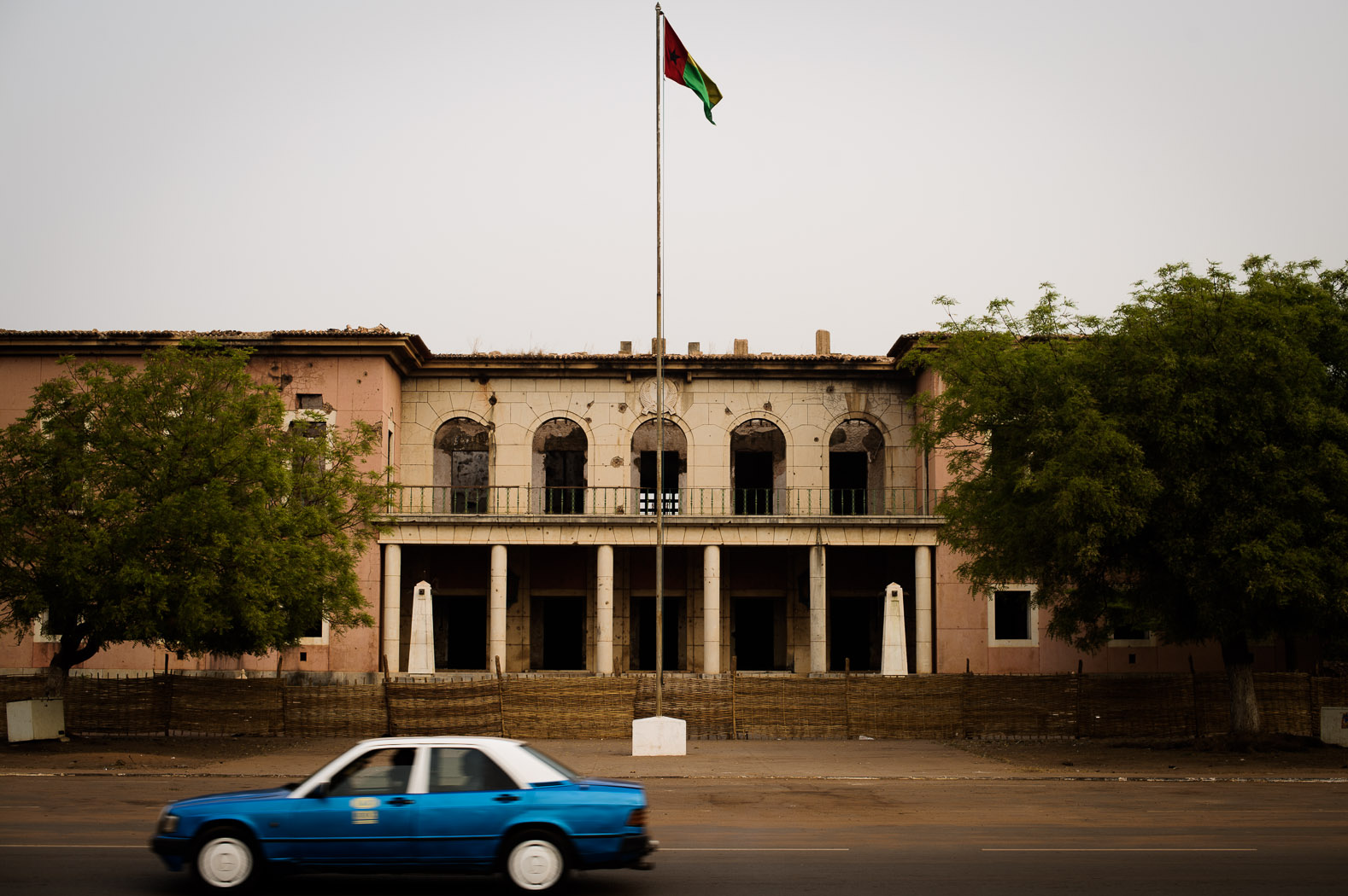 The presidential palace stands derelict after being shot at and set alight during the country's civil war in 1999.