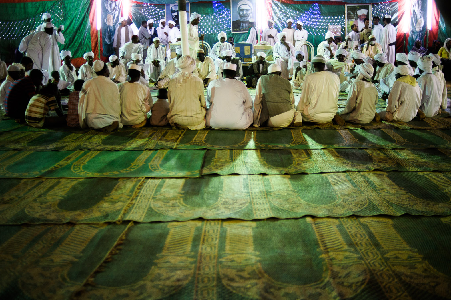 A group of sufis sit listening to stories of the life of the Prophet Mohamed.