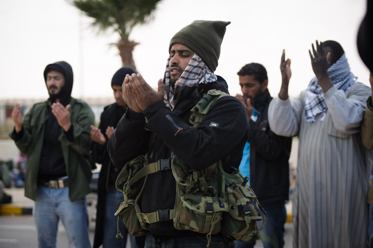 The  dhuhr  prayer following a bombing at a checkpoint in Ras Lanuf.