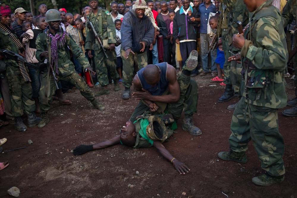 Troops celebrate the fall of Bunagana