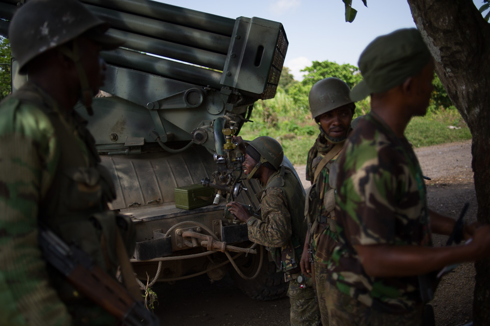 Troops aim a rocket launcher towards M23 positions in the hills around Bunagana