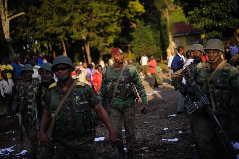 Jubilent troops walk through Bunagana