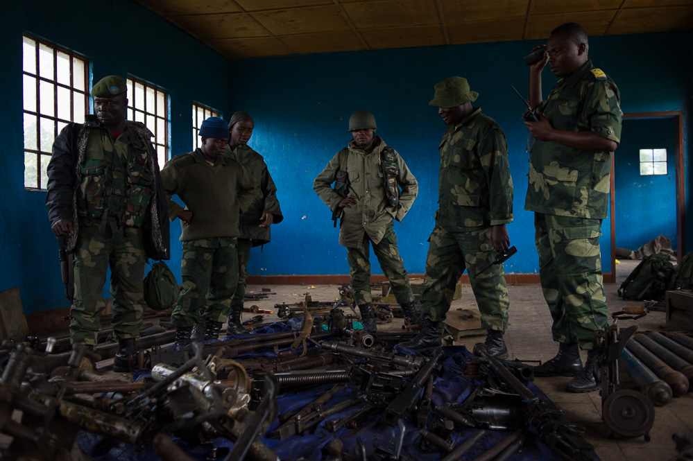 FARDC soldiers examine captured munitions at the Rumangabo military academy, formerly a major M23 base