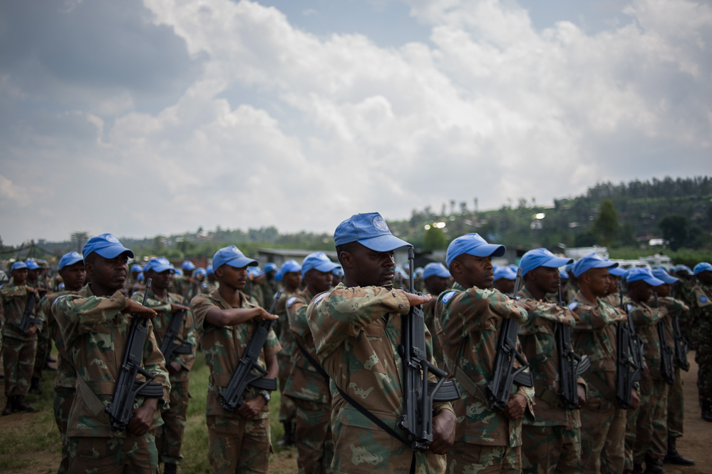 UN troops during a ceremony for a Tanzanian peacekeeper killed during the operation to recapture Kiwanja