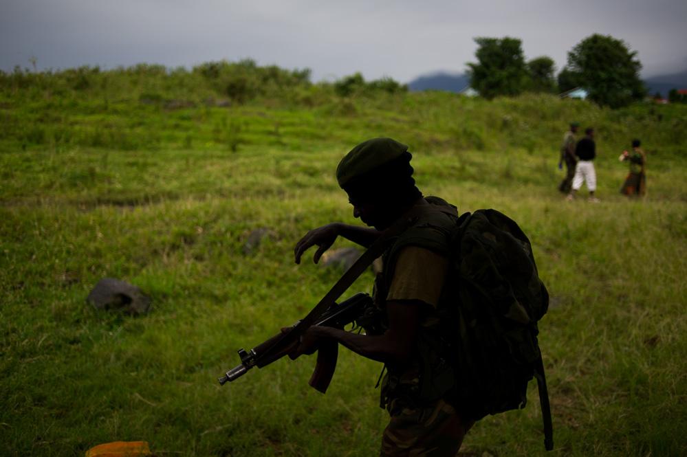 FARDC soldier walks through the recaptured Rumangabo military academy