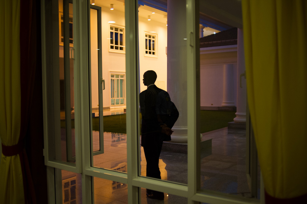 A State House Security guard stands outside the negotiating room