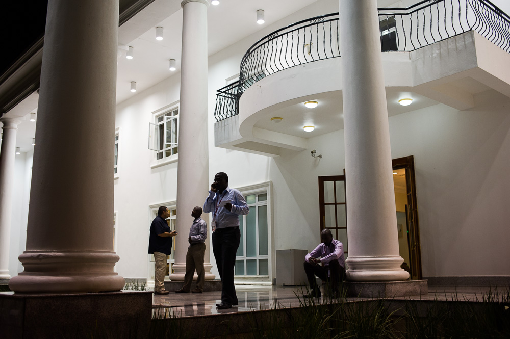 Members of the press make calls outside of State House (phones were banned inside), whilst waiting for something to happen
