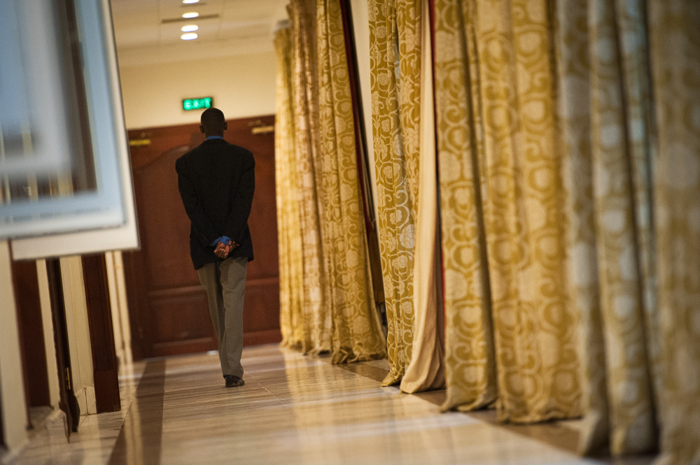 State House security walk the corridor outside the negotiating room as talks break up
