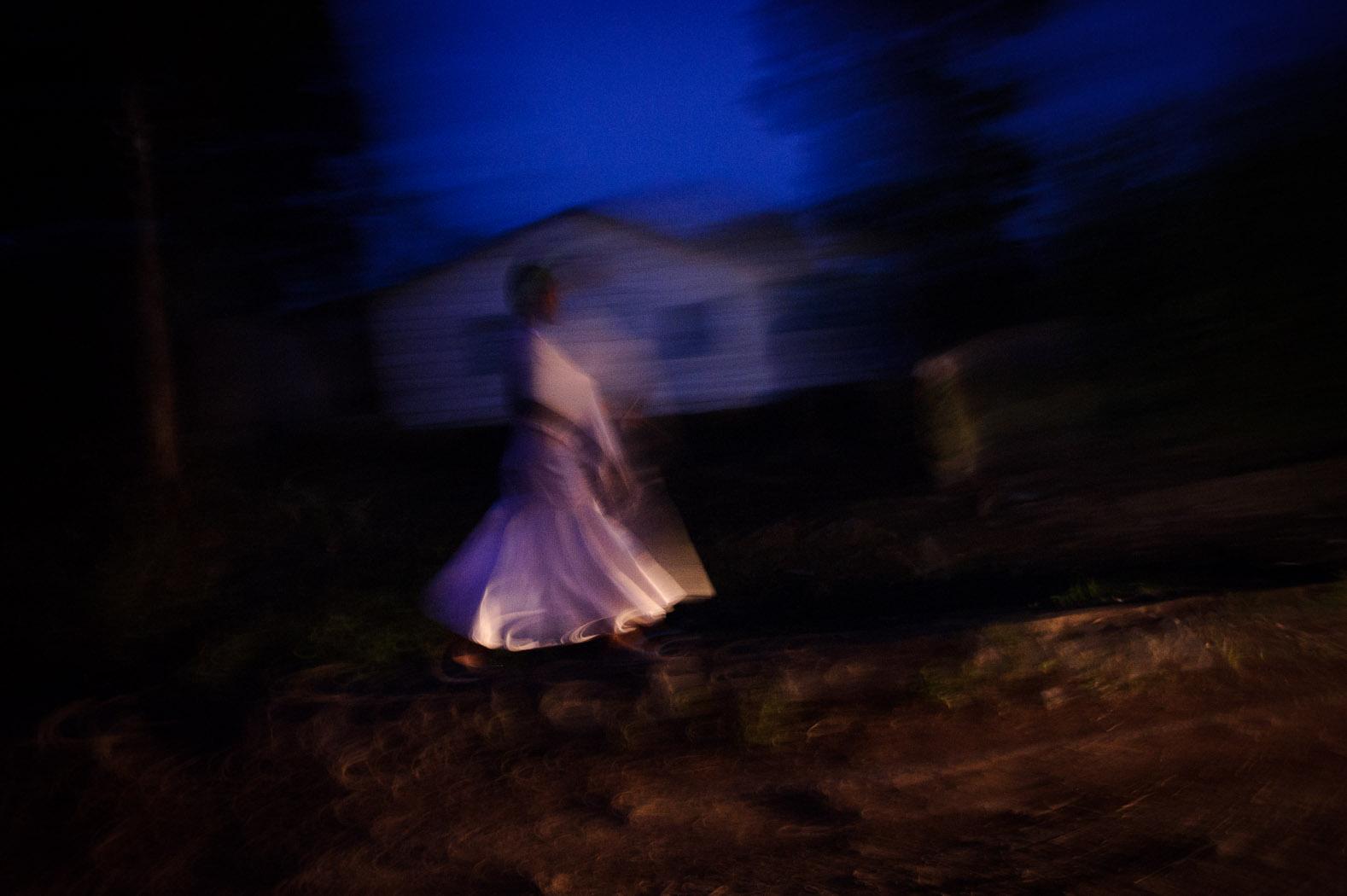A girl walks towards Goma