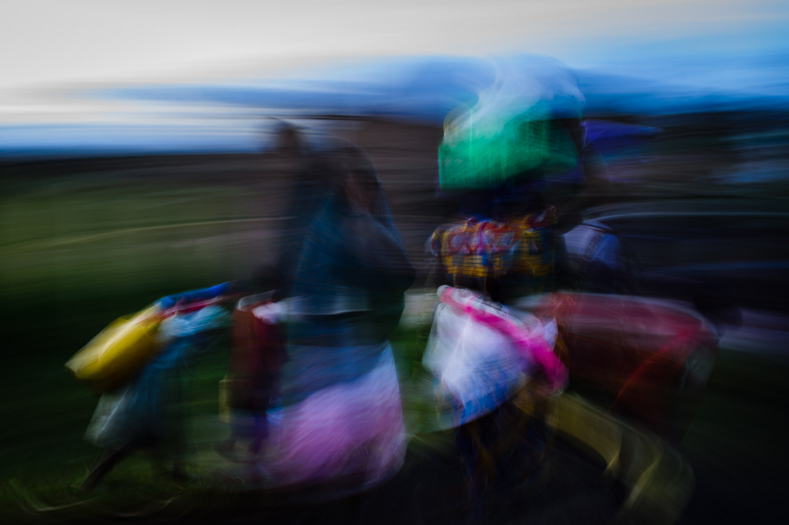 Congolese refugees carry their belongings towards the refugee camp in Kisoro, Uganda