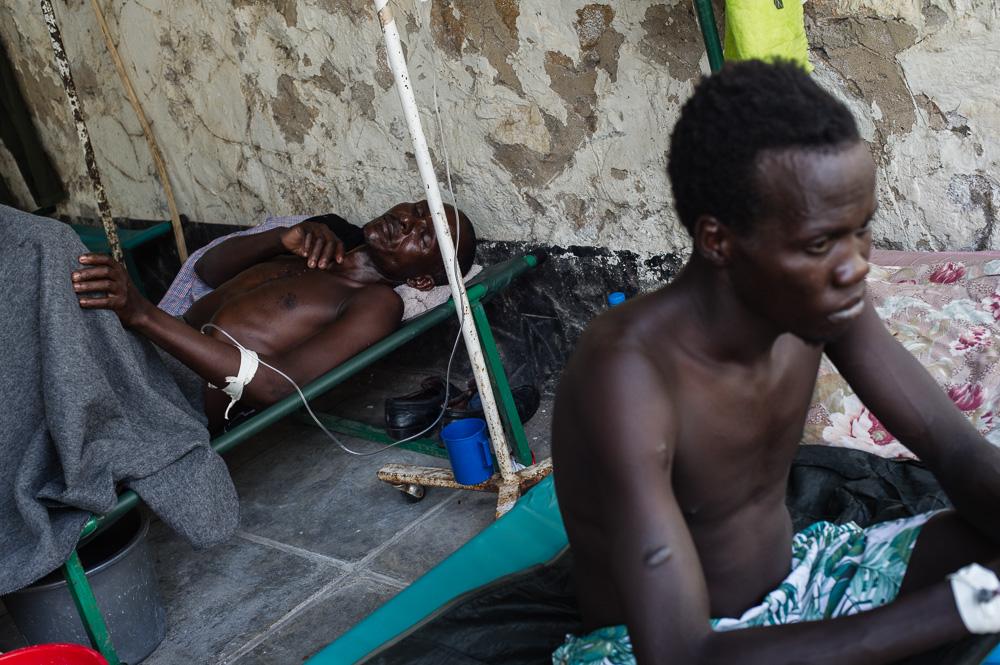 Cholera patients sit at the Juba Teaching Hospital