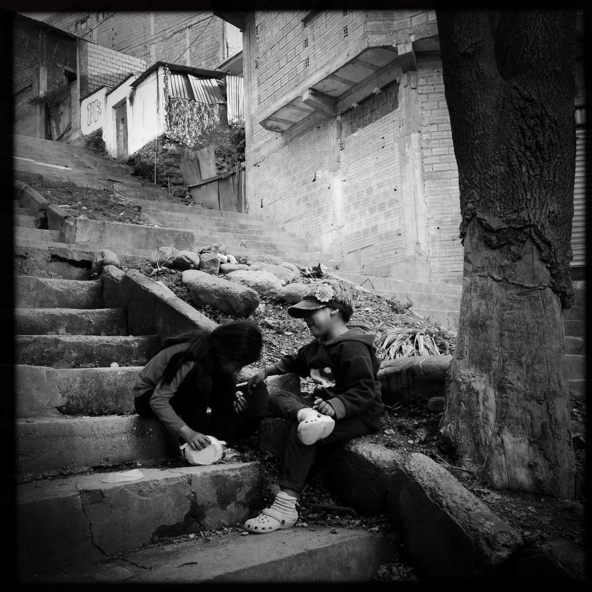 Young girls play on a steps cutting through Coripata