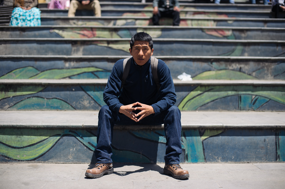 "William Walas Cruz (28) poses for a picture in the San Francisco plaza in central La Paz, Bolivia. William helps to run the ""New Day Foundation"", a centre for shoe-shiners in the Bolivian capital. He is also studying business administration at university in La Paz."