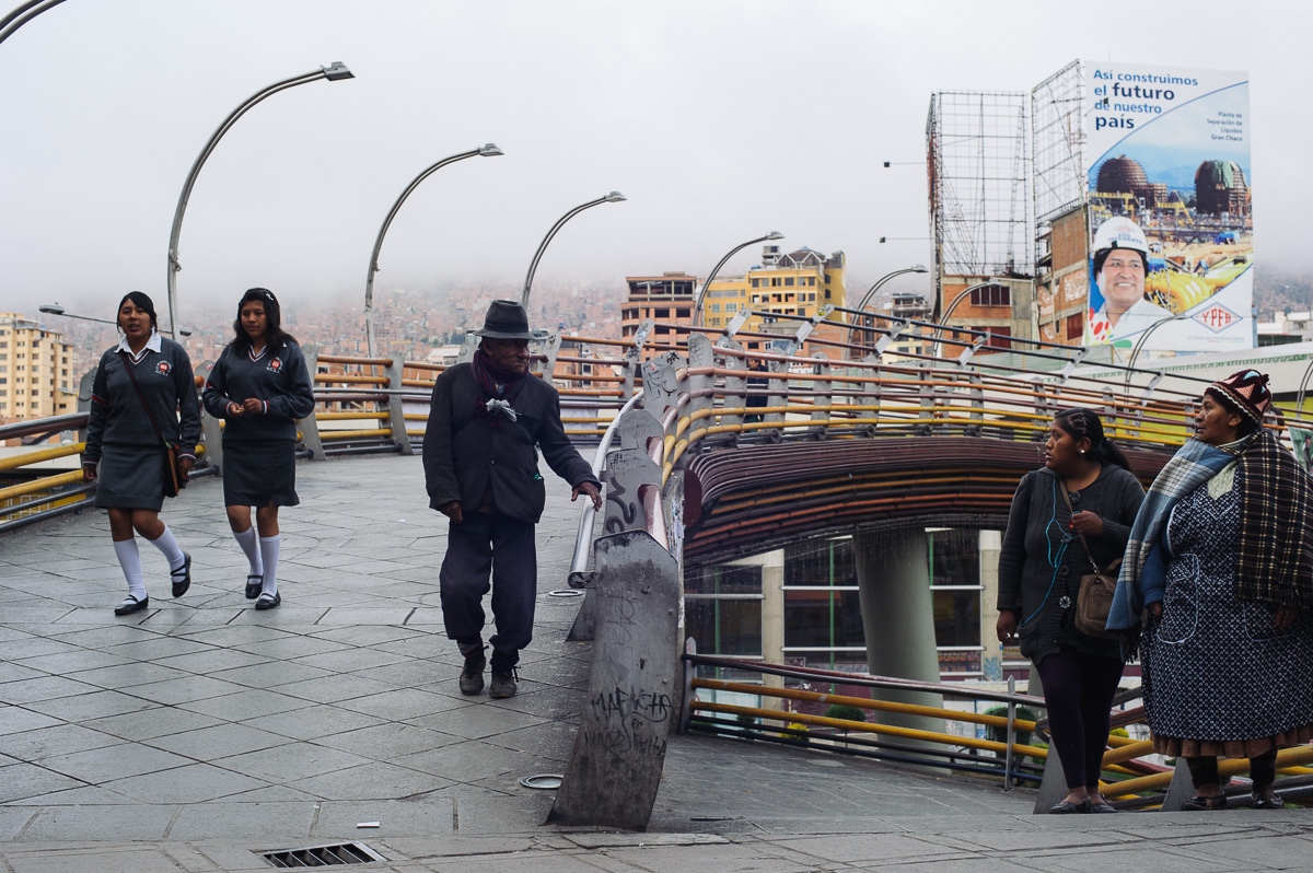 "Schoolgirls walk to school in the early morning in La Paz, Bolivia. ""In Bolivia, there are two societies: those who raise their children to have an education and one day become president; and those who raise their children to work to survive"" says Alex Narvaez, who deals with child workers in the city of El Alto."