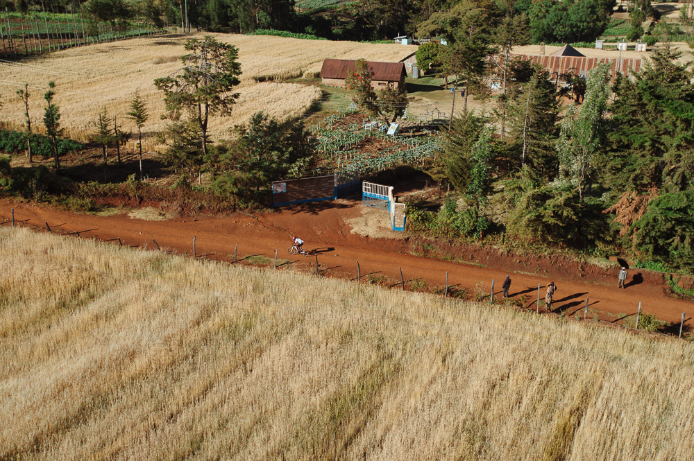 A competitor rides through the farm lands cutting near the Borana conservancy