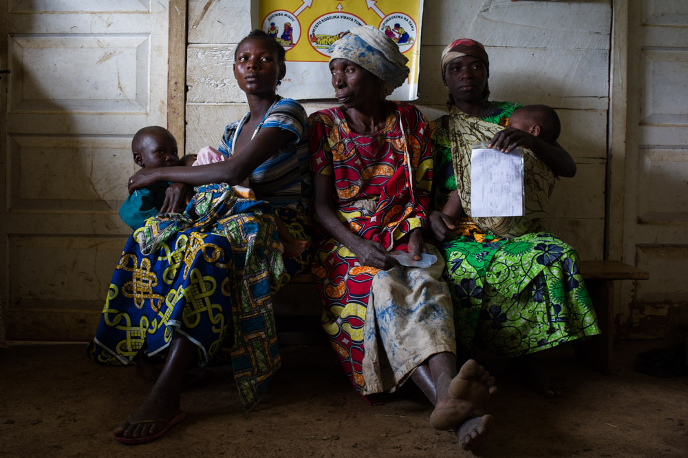 Women sit in a health centre in Lukweti, during an MSF mobile clinic that visits once a week.