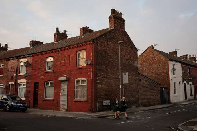 Two girls walk through typically working-class terraced housing in the neighbourhood of Walton in Liverpool, England, on November 22, 2018. Walton is considered one of the Labour party's safest seats in the country, but is described as a deprived area. It was hit hard during the 1980s and exacerbated by the economic crash of 2008. The constituency voted to leave the European Union in the 2016 referendum, bucking the trend of the city as a whole, which voted to remain.