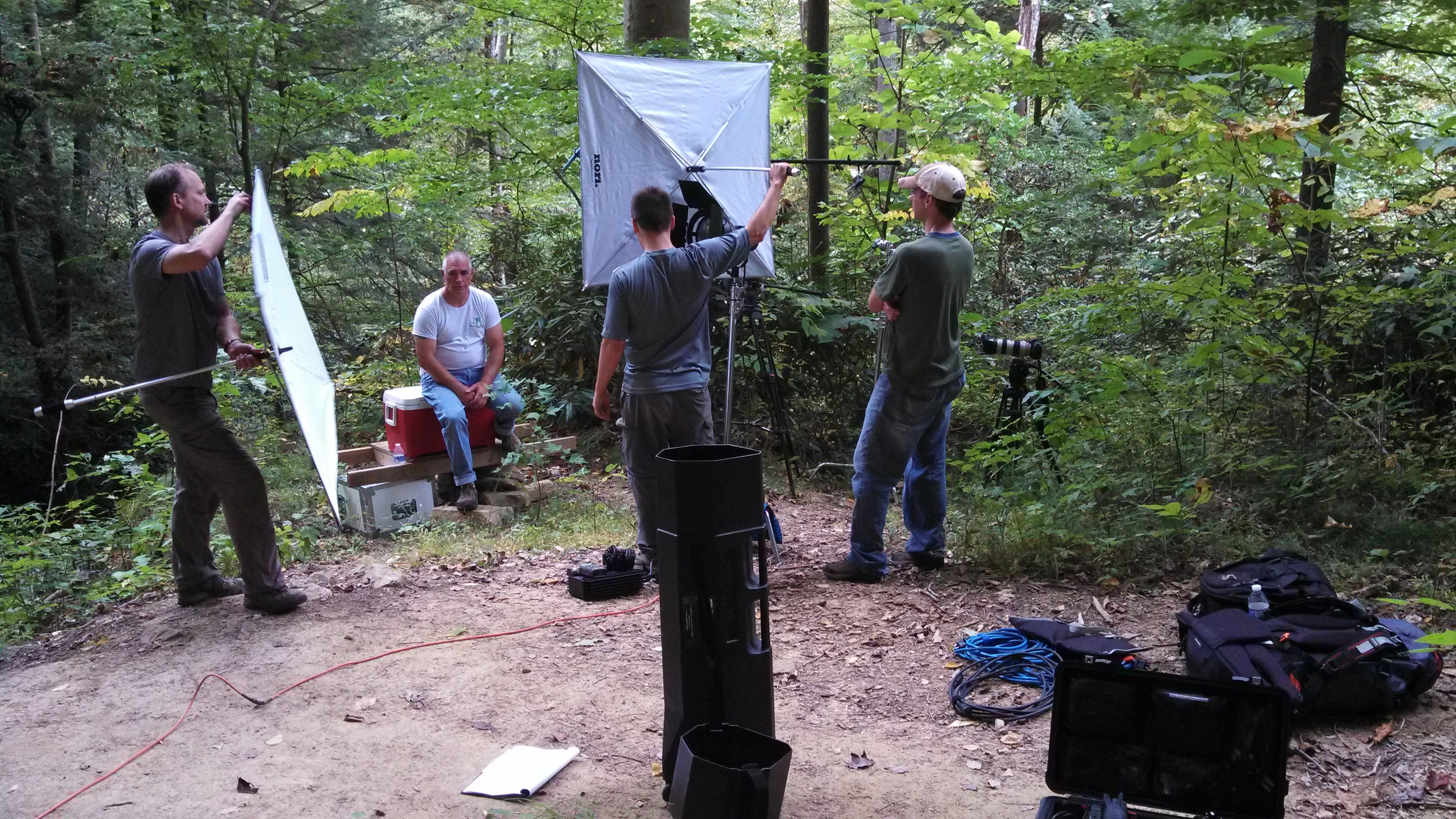 You need people who are willing to put in long hours and jump into various roles.  There aren't production assistants, grips, electricians, wardrobe or assistant camera people in the woods.  You've got people who do it all and people who don't... well they aren't there because you didn't hire those folks.