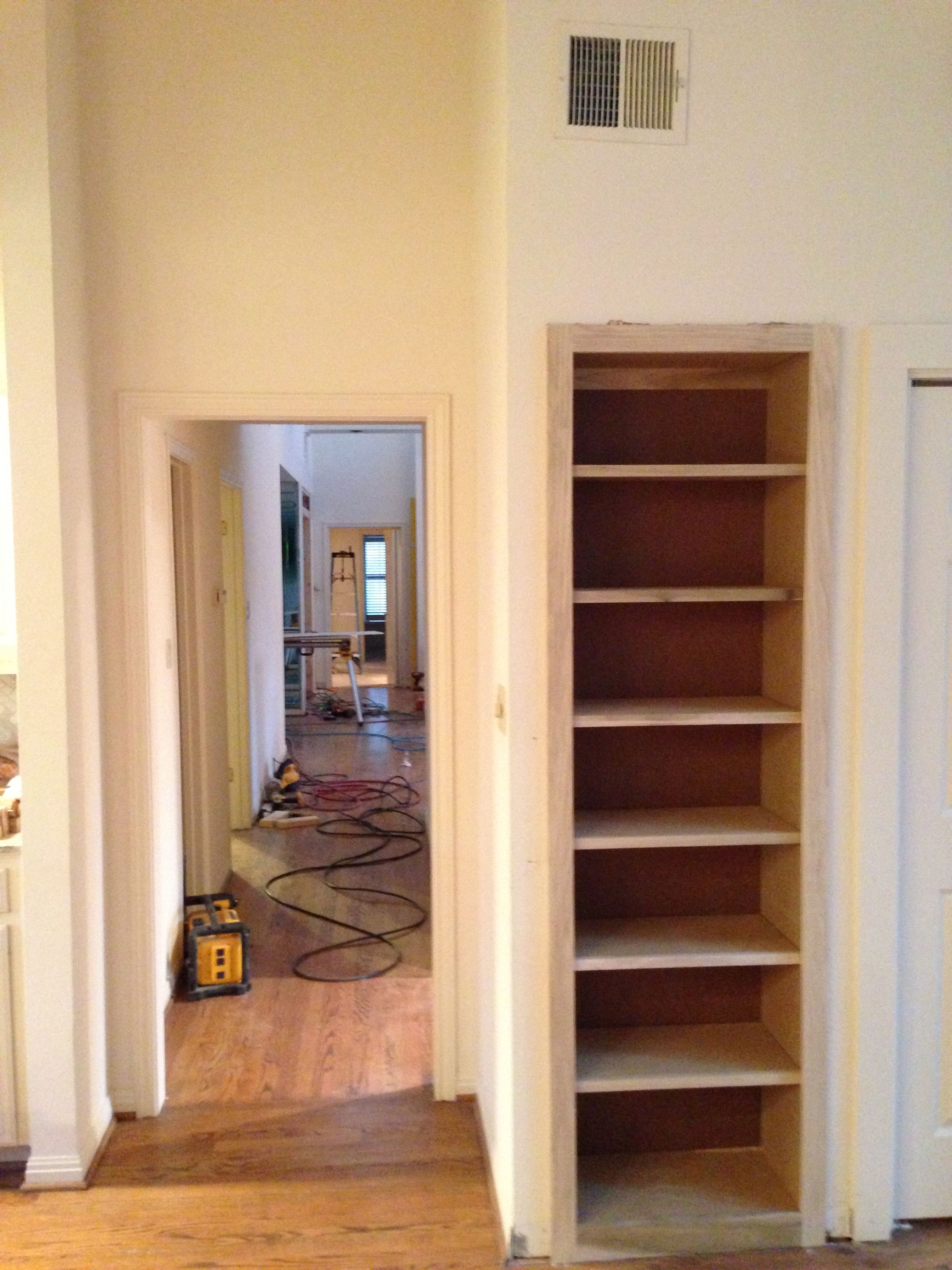 The bookcase for the Client's collection of cookbooks has been installed.