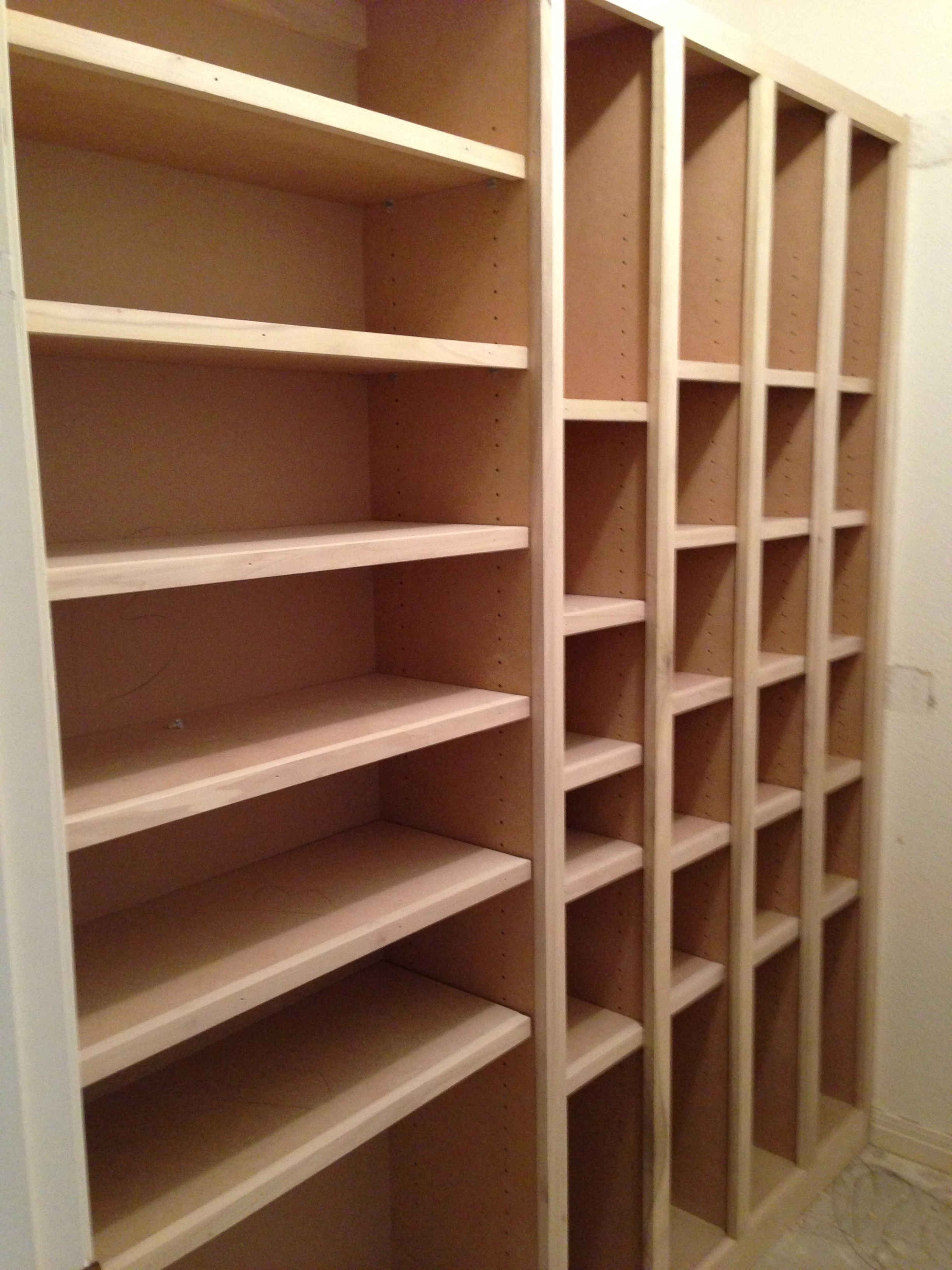 The first half of the Shoe and Boot Closet has been placed. Specialized hanging for the Client's scarf collection and bench are yet to be installed.