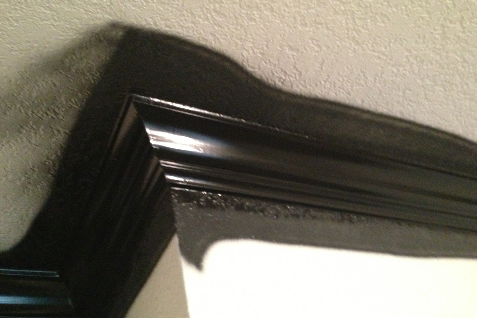 The glossy black will settle down to a rich satin finish. The walls and ceiling will be a true photo neutral gray.
