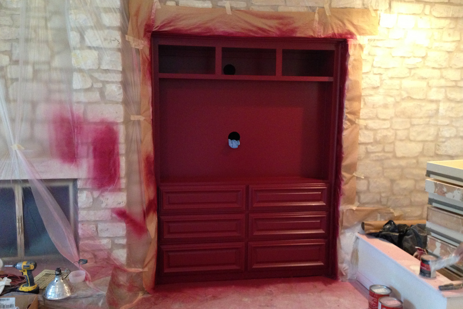 """I was able to snap one photo of the entertainment cabinet in the Master Bedroom before the upper doors were reinstalled (which hold speakers and hands free components) before it was """"bagged"""" to protect it while other painting happens in the room."""