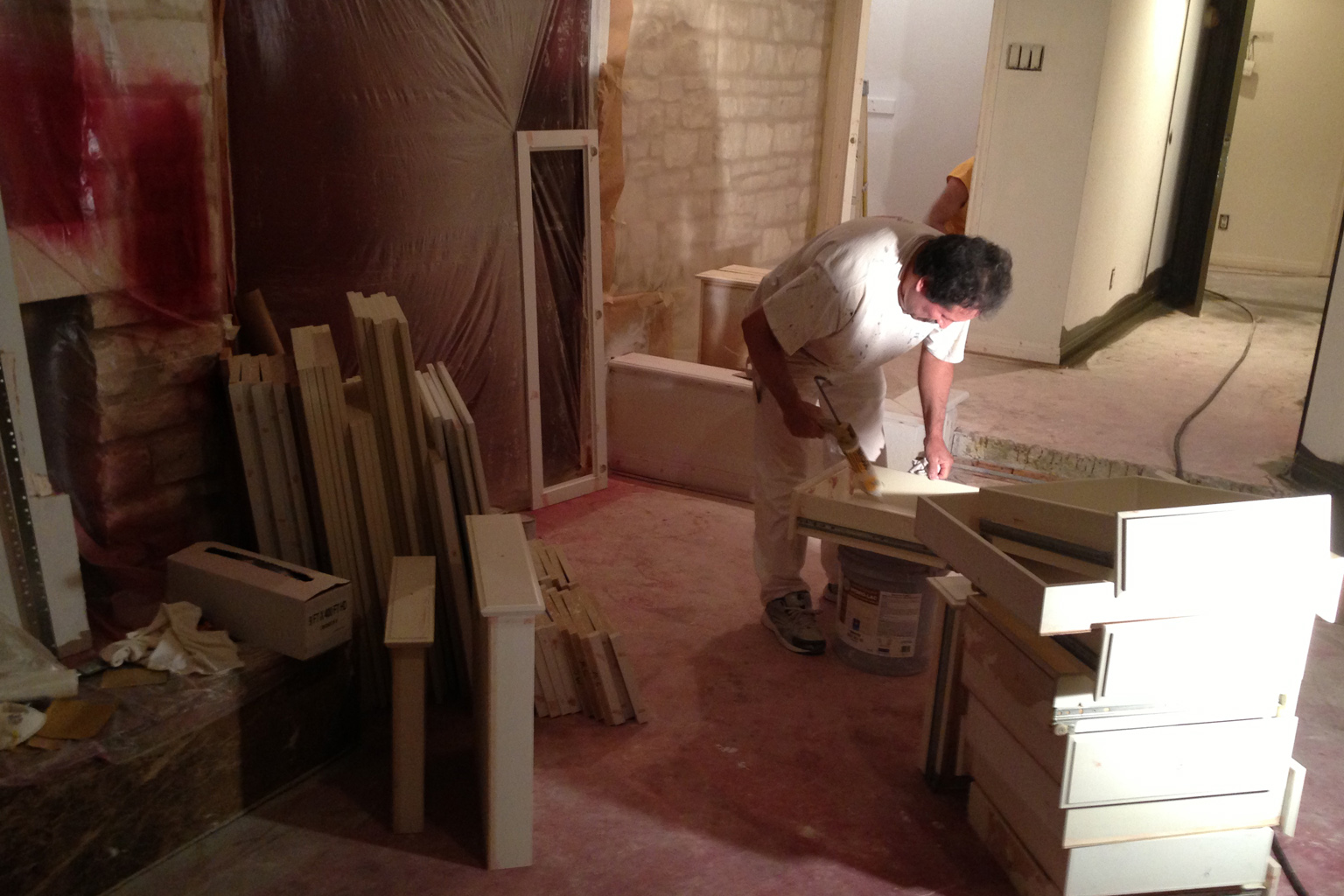 Each piece of old cabinetry is cleaned, sanded, primed, sanded, filled and caulked before any paint is actually applied. The painting takes very little time comparatively.