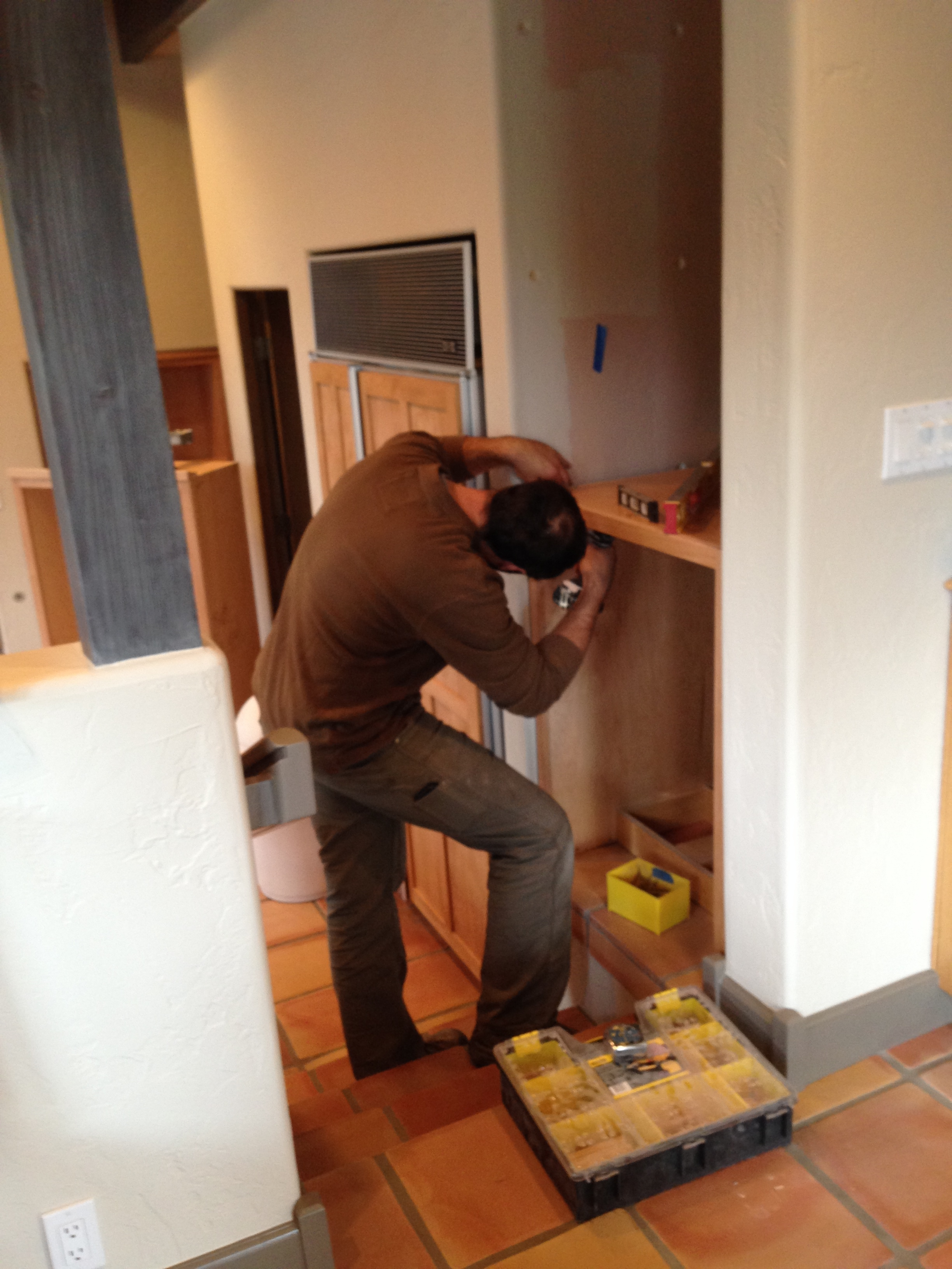 Matt installs the base cabinet level and plumb.