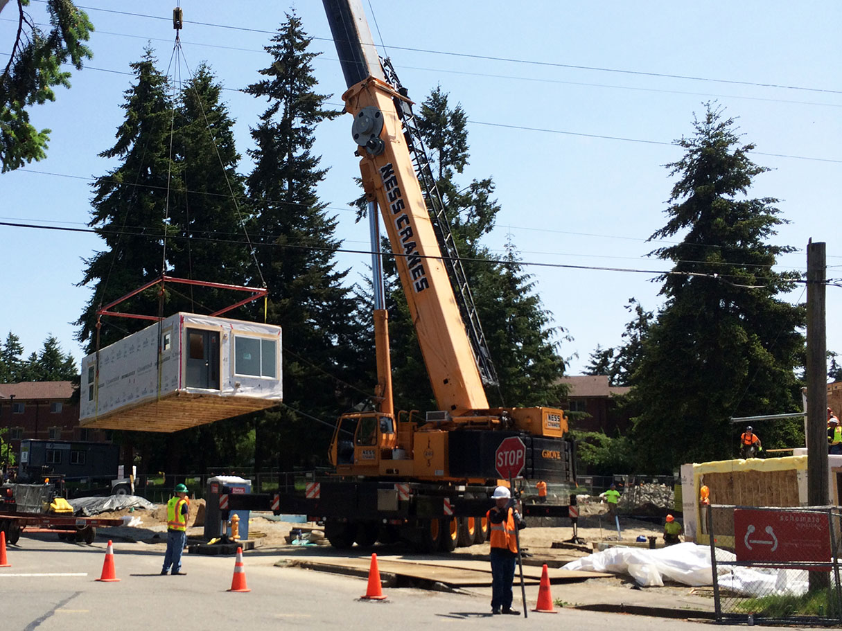 A 250-ton crane was used to lift the boxes onto the foundation.  Special rigging is used and the crane location, and size, was dictated by existing power lines on site.