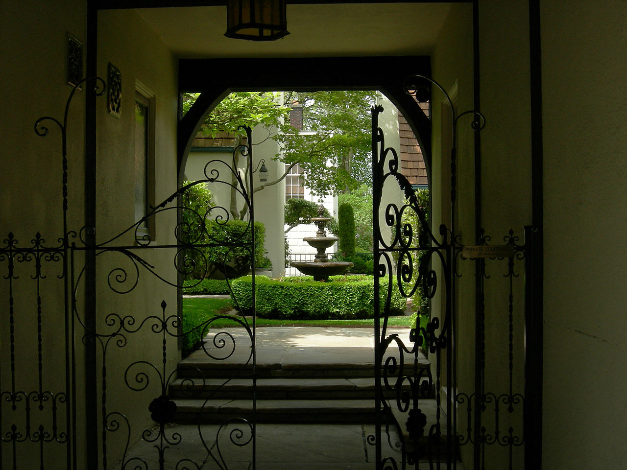 """The Loveless Building scale is outstanding along the sidewalk, as is the material textures, and expression of uses. The glimpse of the courtyard seen passing by the gate is very compelling, followed by the traditional sequence of compression of view in the tunnel, and expansion into the garden, and the tree canopy overhead."""