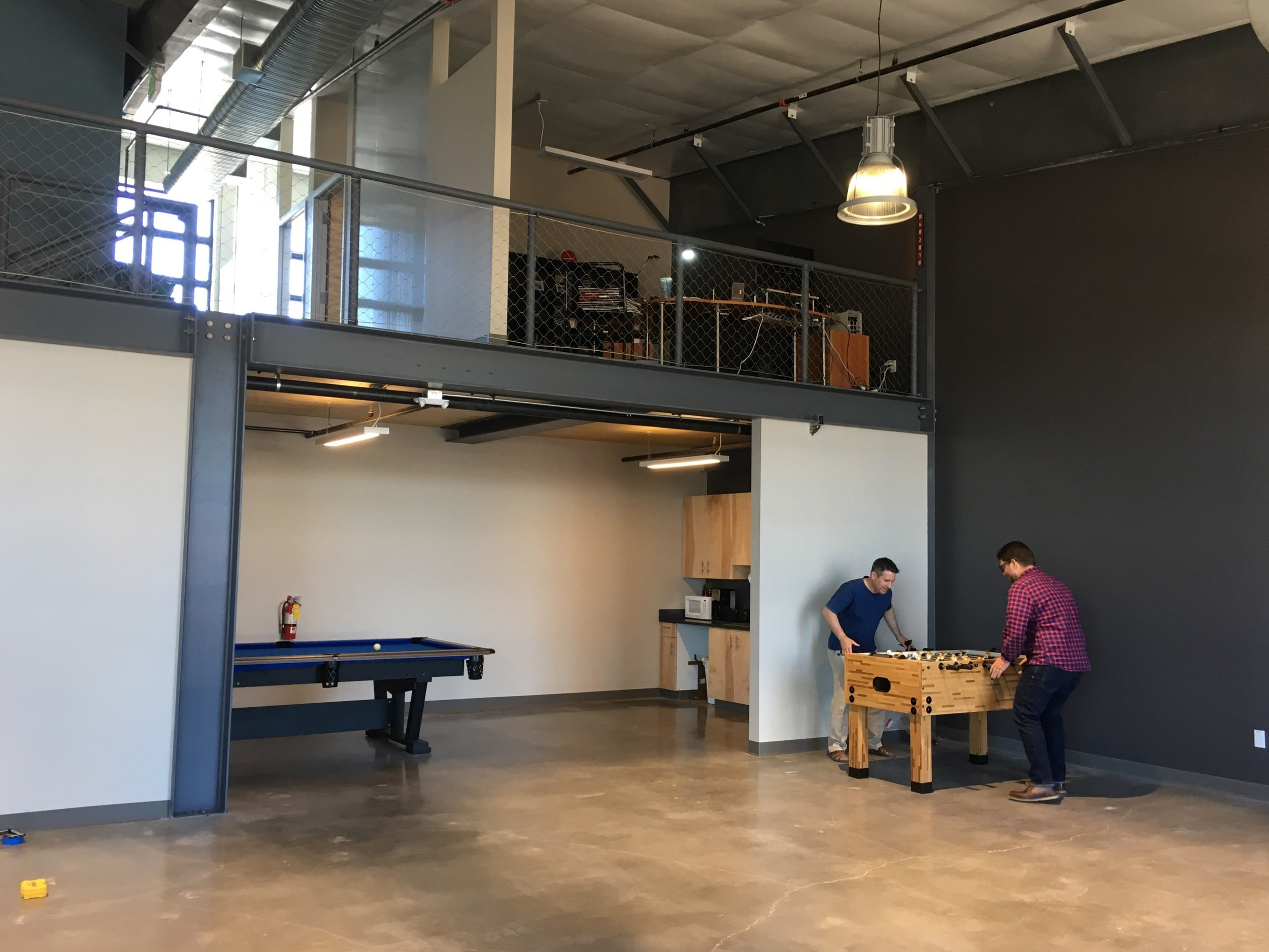 Architects at a foosball table.