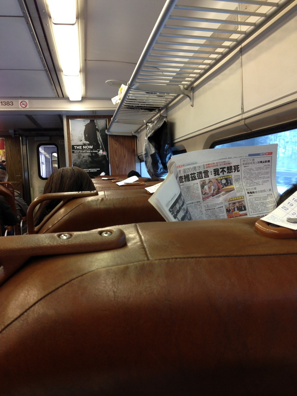 The lady in front of me on the train, and her newspaper.