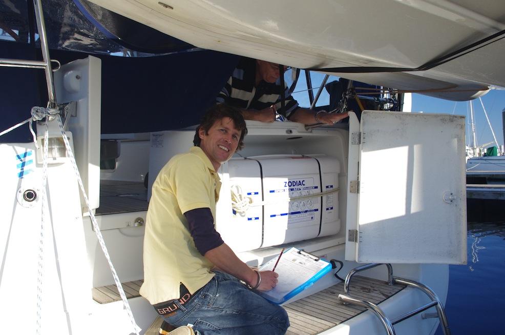 Lyall inspecting a liferaft.